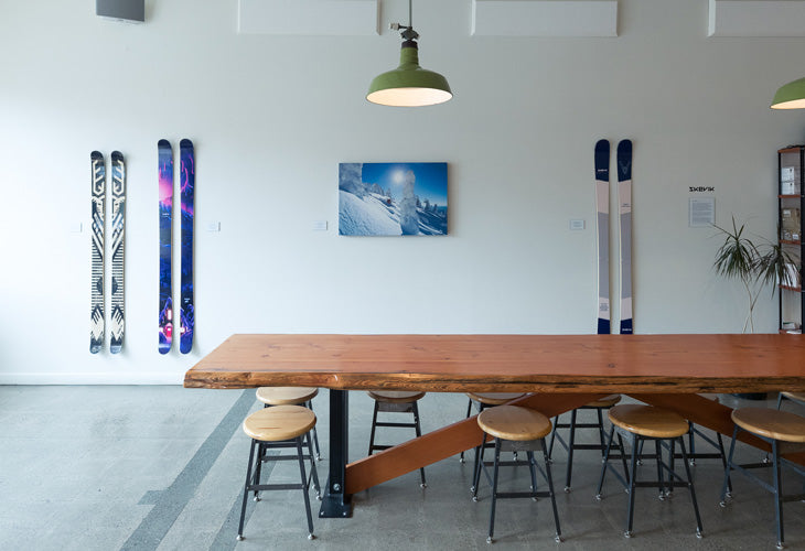 Geoff Holman print surrounded by Anton and Anders skis