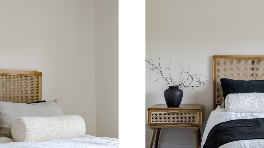 neutral rattan bed with boucle bolster in a bedroom