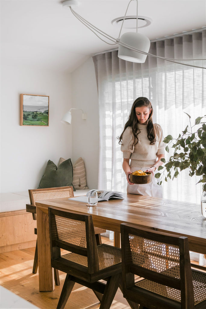 lady at a wooden dining table and chairs