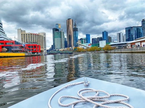 Boat sailing on the South Yarra river looking onto the Melbourne city view