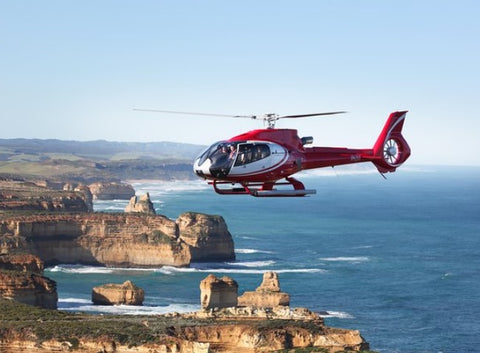 Helicopter in the air above the Twelve Apostles, Great Ocean Road, Victoria, Melbourne