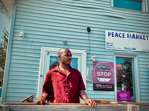 A man standing in front of a storefront