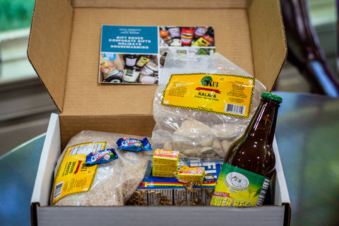A gift box full of African snacks and ingredients