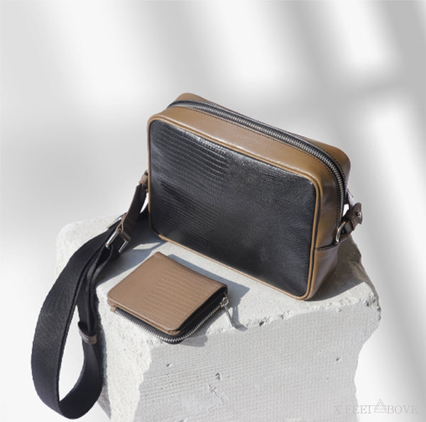 Leather crossbody bag and leather small wallet for women on a stone in shadow. Black and taupe colored sling bag for men and women.