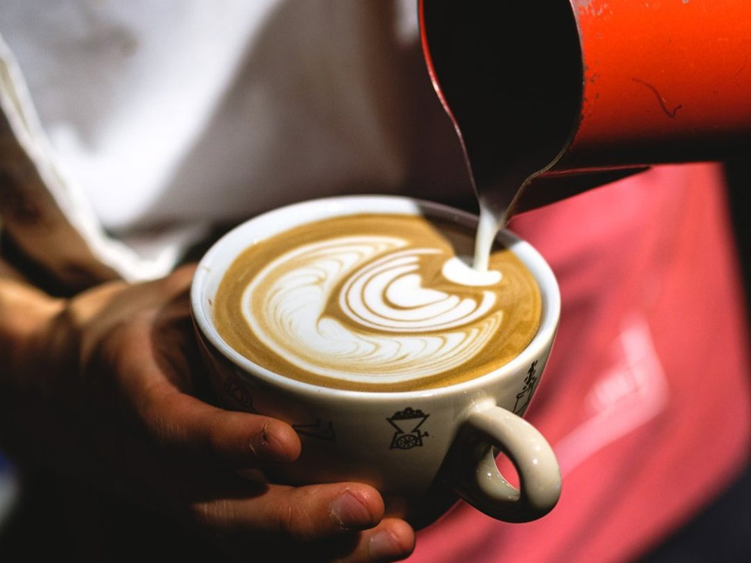 39 Steps Coffee barista pouring latte are design into a coffee cup