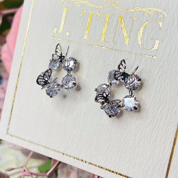Silver Butterflies Atop Five Fold Crystal Flower Stud Earrings