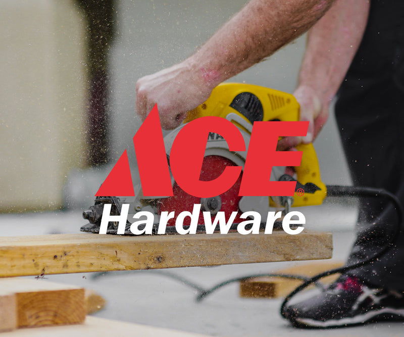 man using saw on wood plank with ace hardware logo on top of image