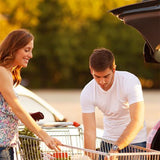 man and woman taking items out of shopping cart