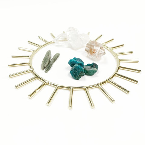 gold sun ring, healing crystals on table