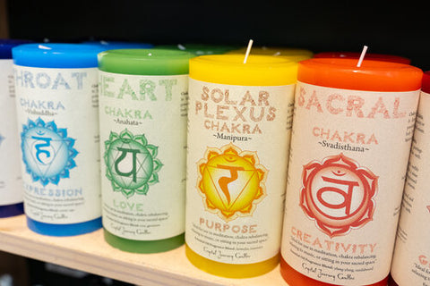 """Alt=""""Blue, Green, Yellow and Red pillar candles"""""""