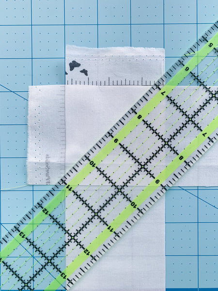 quilting ruler with 1/4 line lined up on sewn line