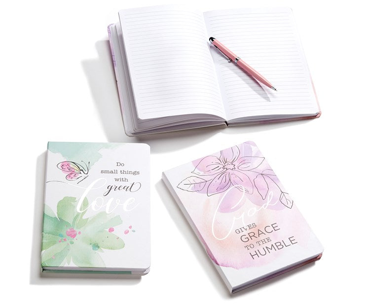 "Spiritual Journals.  Green flower & butterfly design  ""Do small things with Great Love"". Pink with flower design ""God gives grace to the humble"""