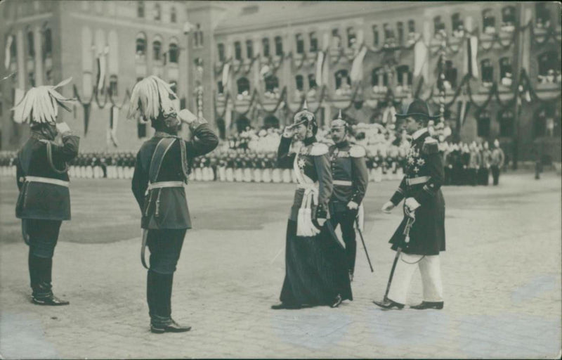 Victoria of Baden, Queen of Sweden and Prince Adalbert of Prussia are greeted by the military at the Stockholm Palace grounds - Reprint