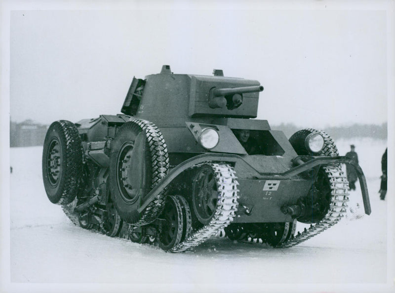 Soldiers operating tank in snow. - Reprint