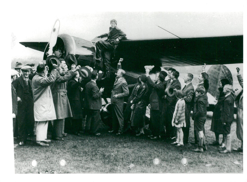 Amelia Earhart is received and celebrated when she lands in Ireland after crossing the Atlantic. - Reprint