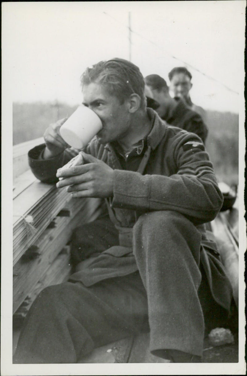 Soldier having a cup of coffee. - Reprint