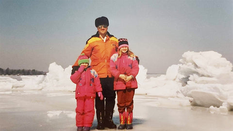 Sisters with their dad on Lake Simcoe in the 90s.