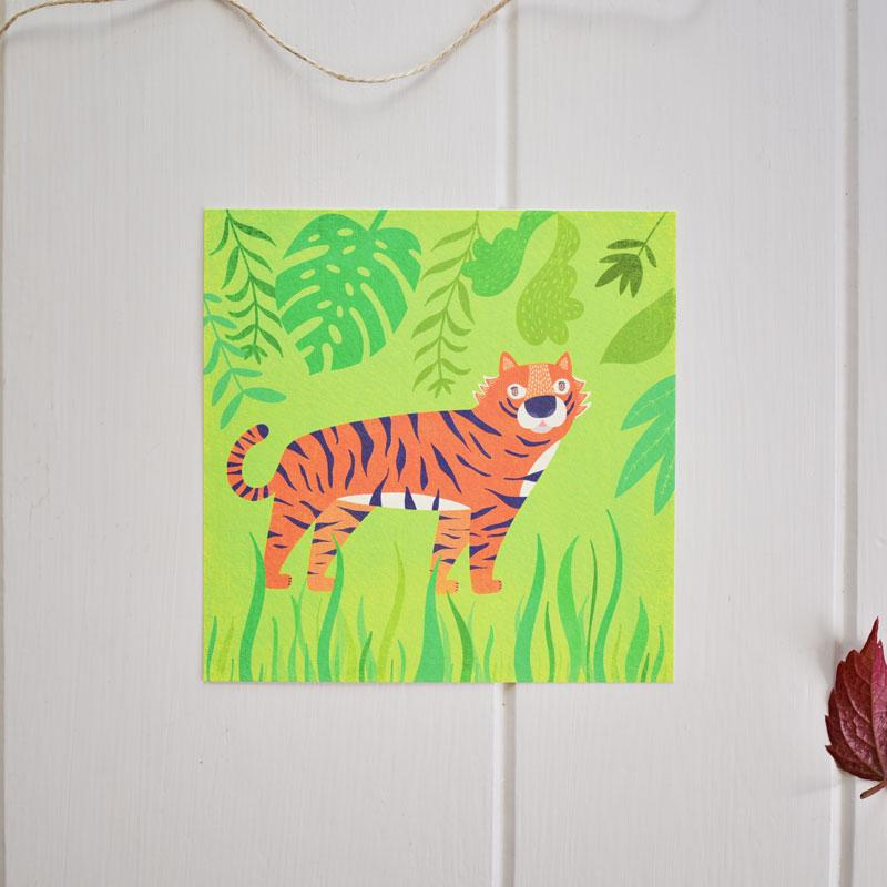 A greeting card of an adventurous tiger roaming through the jungle. Made in Ireland by Fleur & Mimi.