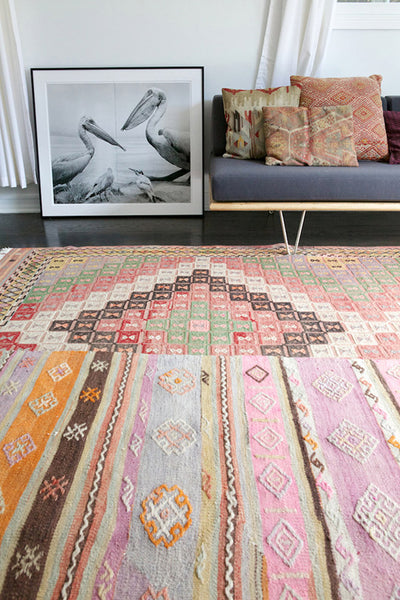Layered rugs in bohemian home