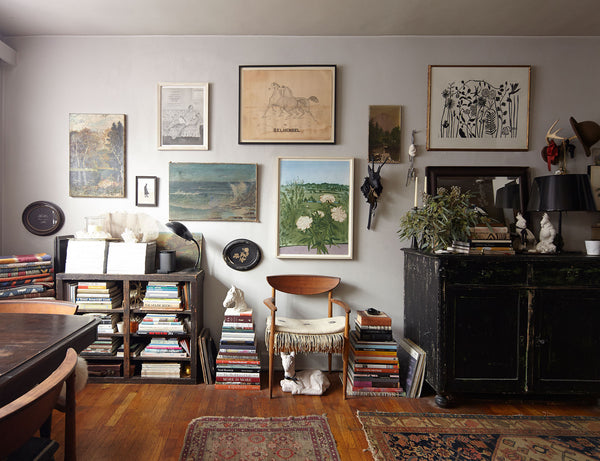 Bohemian art collection with mid century chair and books