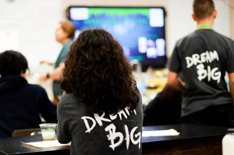 Students learning in a classroom dream big