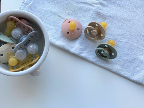 Cleaning pacifiers
