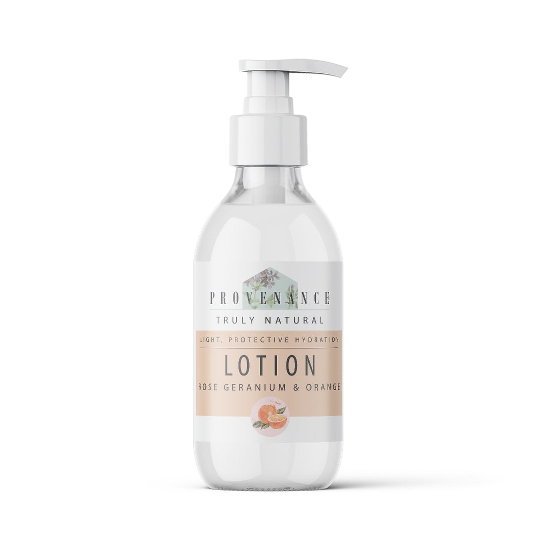 Lotion in clear glass bottle with pump.