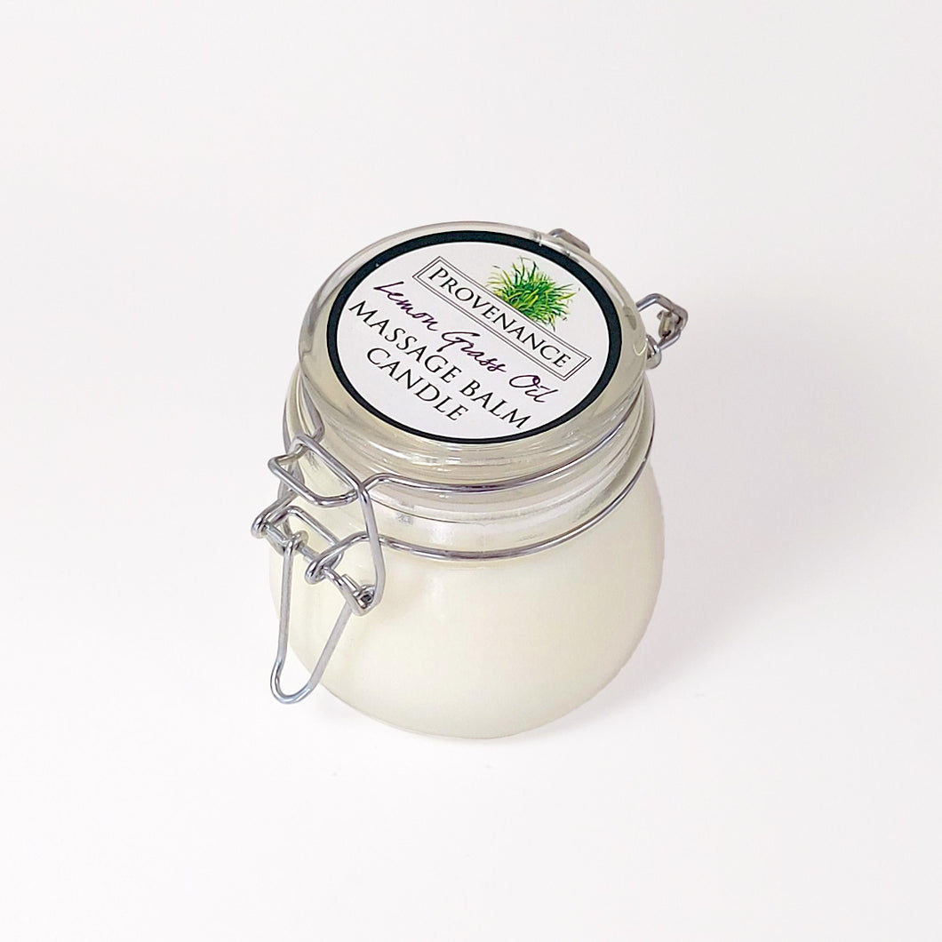 Massage balm candle in clear glass jar with confectionary clamp lid.