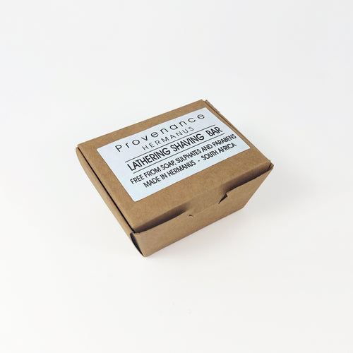Shaving bar in small brown cardboard box.