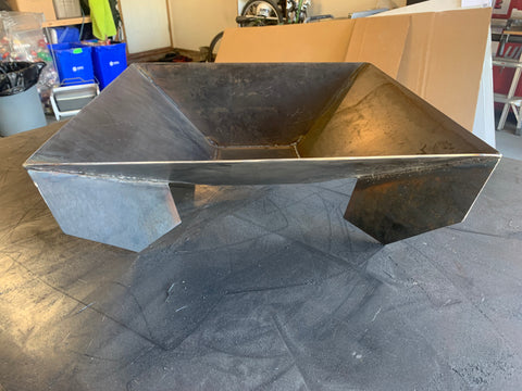 An early Flameworx firepit on the welding table