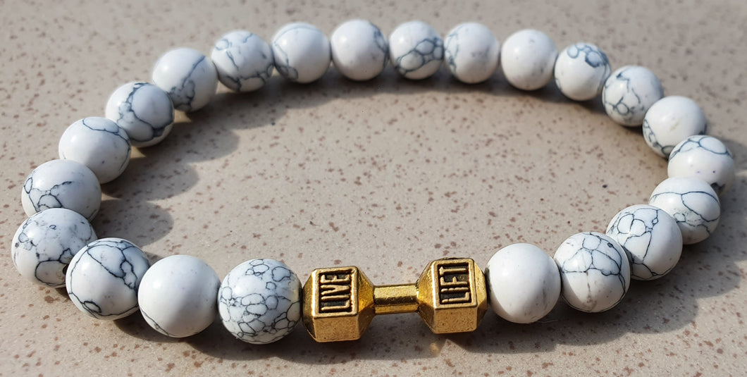<transcy>Fitness bracelet - white stones with a gold barbell</transcy>