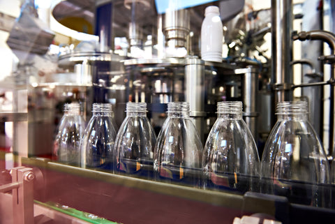 production bottles running down a filling line in a manufacturer facility