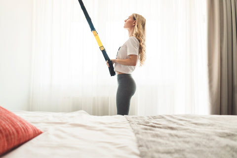 woman using bodypro advanced suspension trainer at home