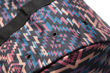 Load image into Gallery viewer, Close up detail of vent holes on the southwestern print duffel bag for travleling
