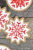 Close-up shot of the cross-stitched snowflake design on the Nordic paper ornaments.