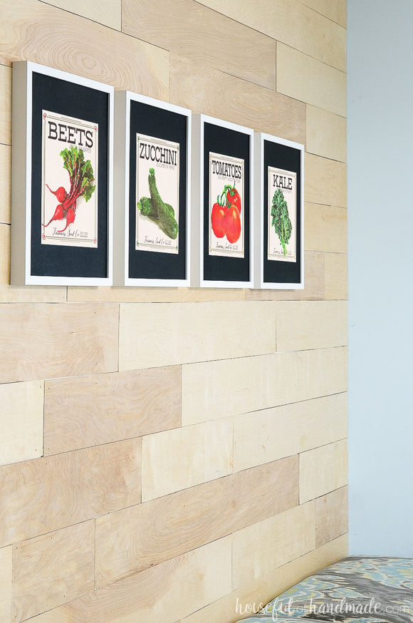Four art prints that look like vegetable seed packets.