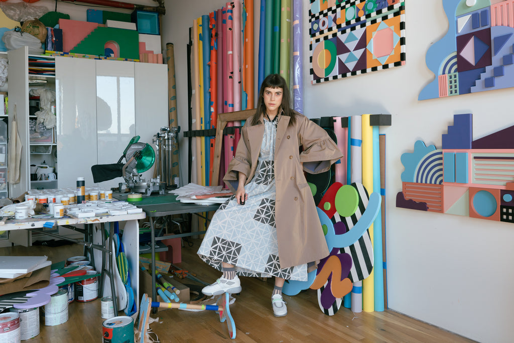Leta Sobierajski in her studio wearing the Seek Collective Goa Dress and her own trench coat