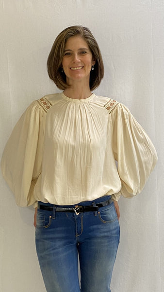 off white top with wide sleeves and shoulder detail