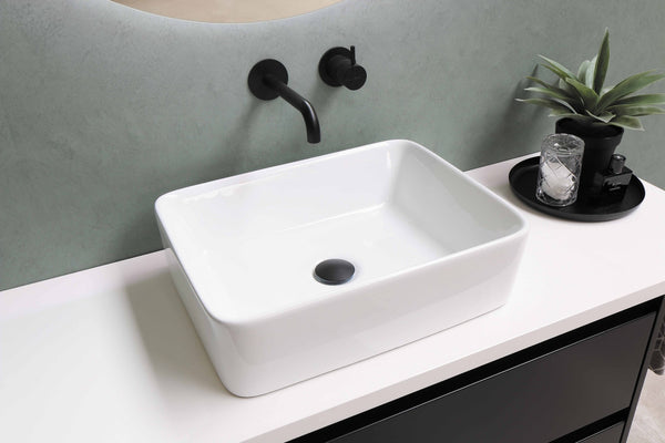 white bathroom sink with black faucet