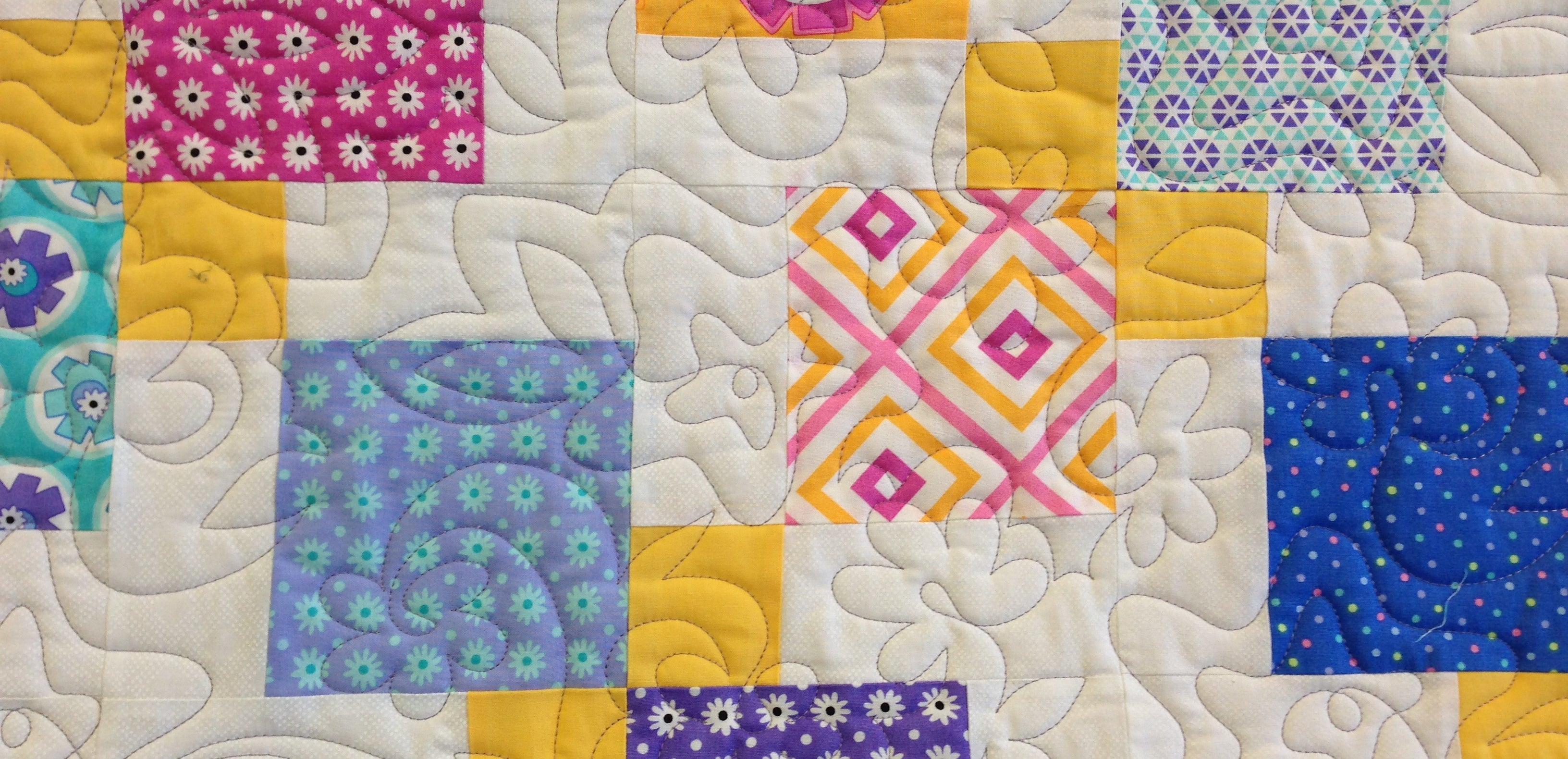 Disappearing 9 patch using Moda Hubba Bubba - pantograph quilting by Suzy Q