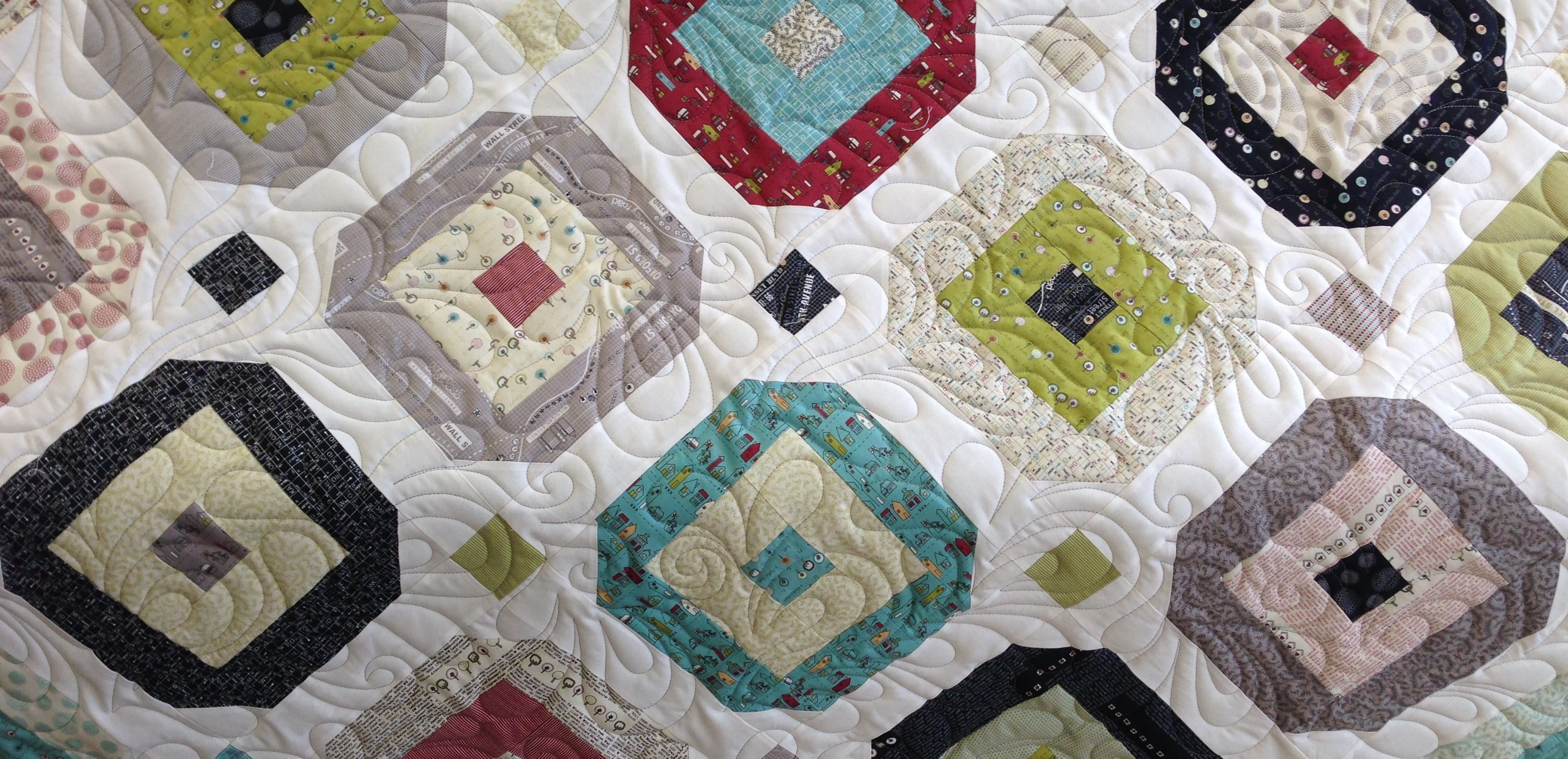 That 70's quilt from Strip Savvy using Moda Road 13 Jelly Roll. Quilted freehand by Suzy Q