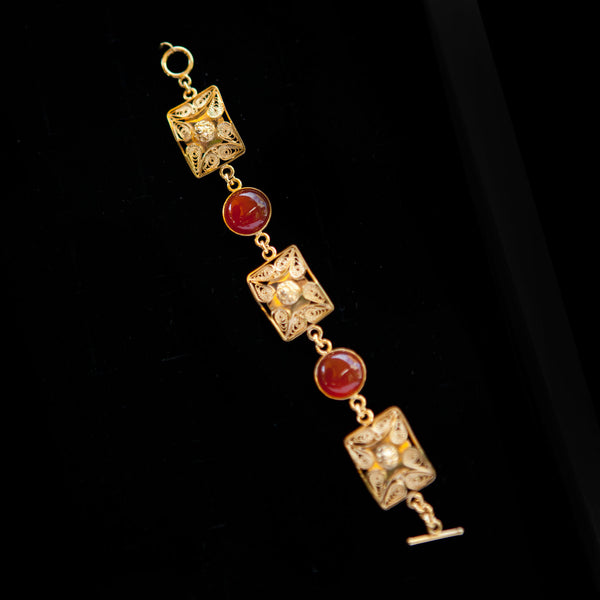 Gold Plated Shapes with Red Stone