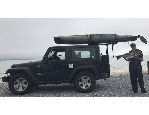 Jeep with kayak mounted on top
