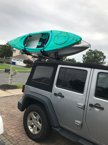 Jeep with Kayaks Mounted Atop.