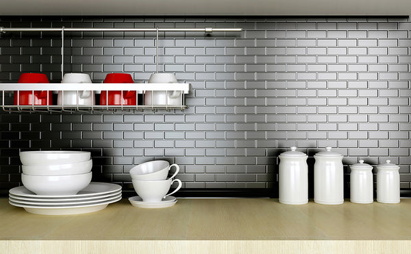 Metal tile install with grey non-sanded grout lines