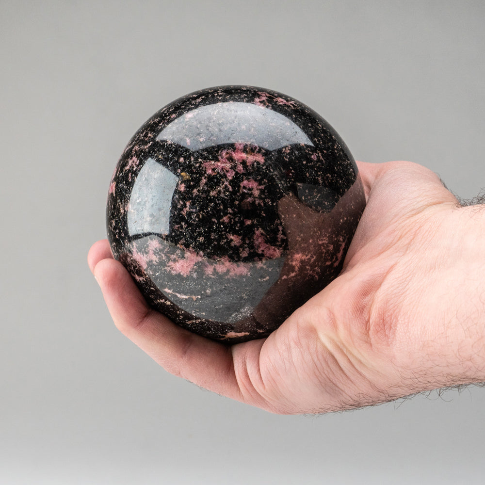 Polished Imperial Rhodonite Sphere from Madagascar (4'', 3.5 lbs)