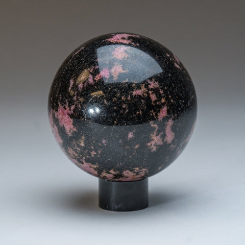 Polished Imperial Rhodonite Sphere from Madagascar (4'', 3 lbs)