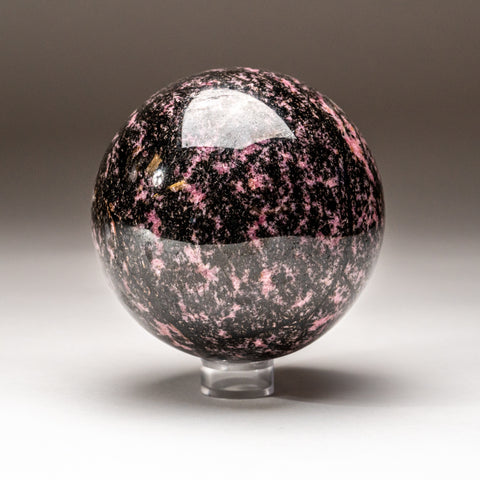 Polished Imperial Rhodonite Sphere from Madagascar (3'', 3.2 lbs)