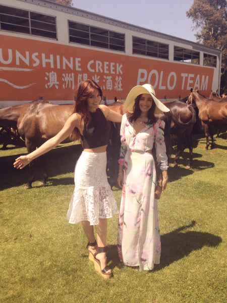 Kasia Z and Nat De Corte dressed for the polo at Seagulls of St Kilda