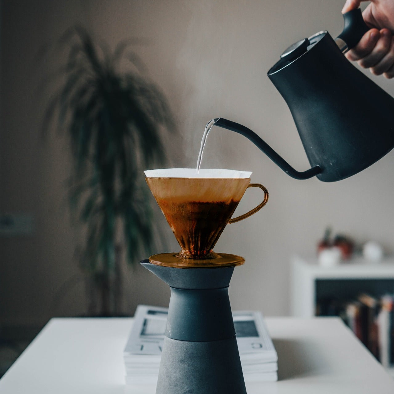Pouring coffee into a coffee dripper by Ordinary Better